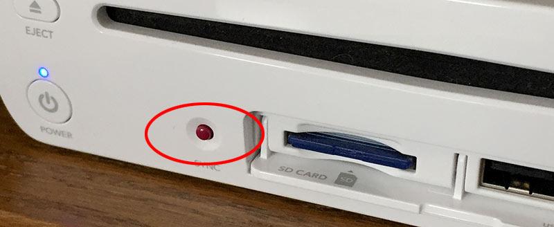 Wii U - Sync-knapp på framsidan av konsolen